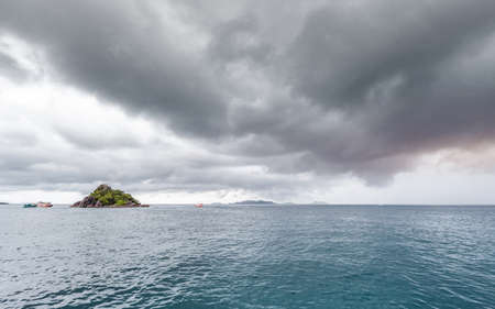 beautiful scenic island with traveling boat while raining strom near comes it is dangerous weather