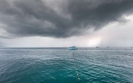 Traveling boat with passenger go to island while raining strom near comes it is dangerous weather