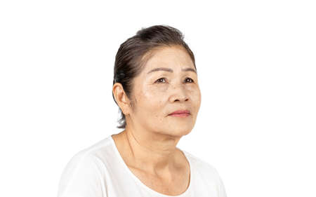 elderly asian woman portrait 60-70 years old no make up with white clothes black hair and hazel eyes isolated on white background Archivio Fotografico