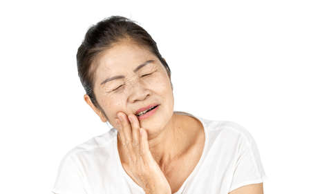 elderly asian woman portrait 60-70 years old have pain with toothache isolated on white background, Dental health care concept