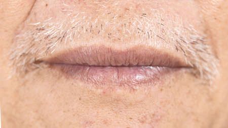 close-up of elderly asian man mouth with wrinkle on face, health care concept