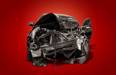 carcass of crashed black car in front side isolated on crimson red burn background with clipping path, Car insurance and accident concept
