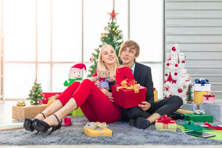 happiness hansome man and pretty woman with colorful decoration gift boxes for new year celebration party