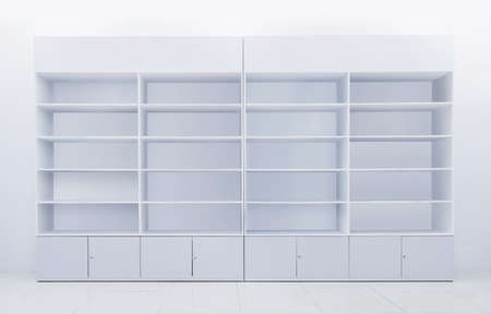 white shelf made from formica laminated for merchandise showing or display in retail shop Imagens