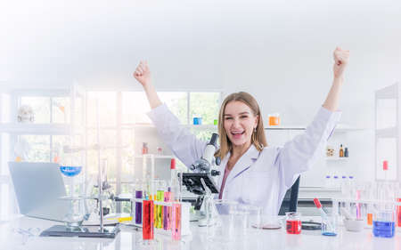 pretty scientist work reserching and cheerfully in chemical laboratory, Science and healthy or medical concept
