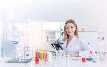 pretty scientist work reserching in chemical laboratory, Science and healthy or medical concept Stock Photo