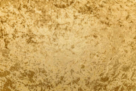 golden velvet fabric textured close-up detail, luxury background concept Stock Photo