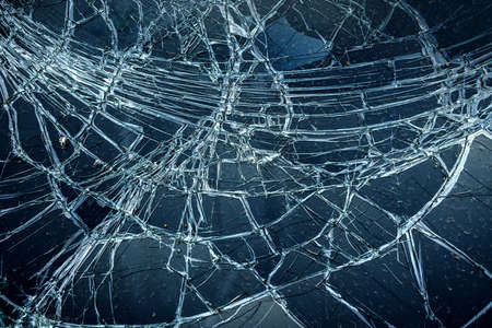 Cracked glass from car crash accidental with selective focusing, broken glass texture Stock Photo