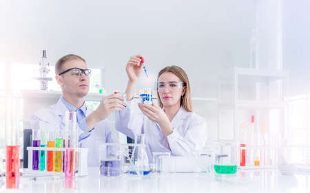 Scientists researching for some confidential in chemical laboratory, teamwork and scientist working concept Stock Photo
