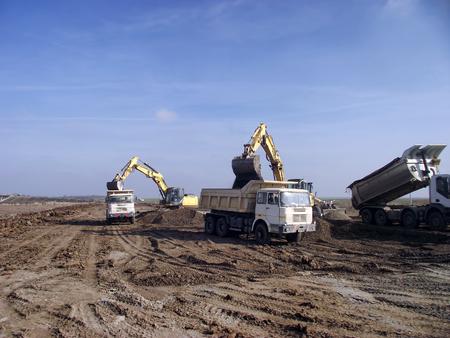 Excavator load trucks