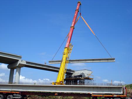 Crane fixed the concrete beam