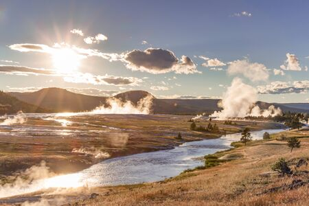 Late evening view of steam rising from the many hot springs of Midway Geyser Basin in Yellowstone National Park, WY, July 2015.