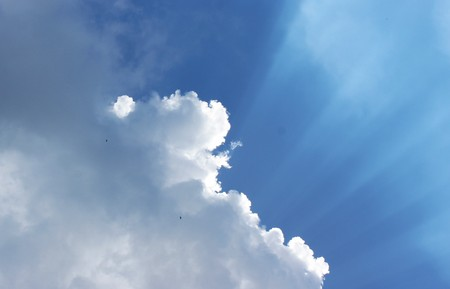 blanketed: Sun over cloud