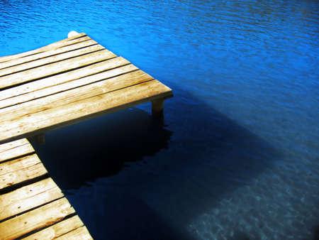 dive trip: Footbridge and intense blue lake Stock Photo