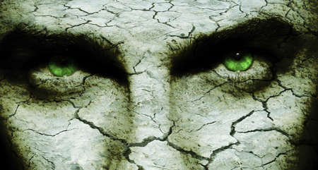 Cracked and dry skin on a man`s face, with diabolic eyes photo