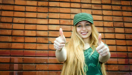 Cute smiling blond girl showing thumbs up Stock Photo - 2924752