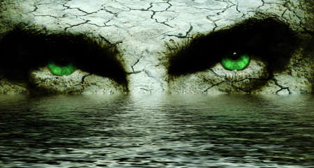 Mysterious cracked face with intense green eyes photo