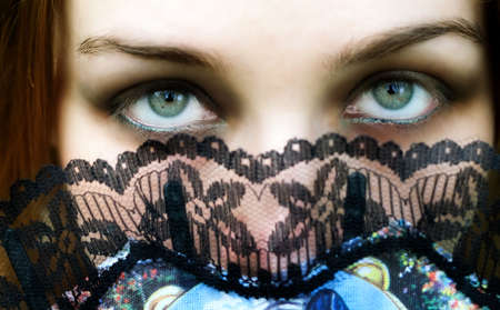 Mysterious woman with intense green eyes  photo
