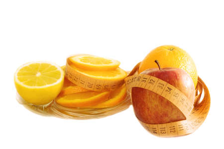 Diet concept: fruits and a meter, on white background photo