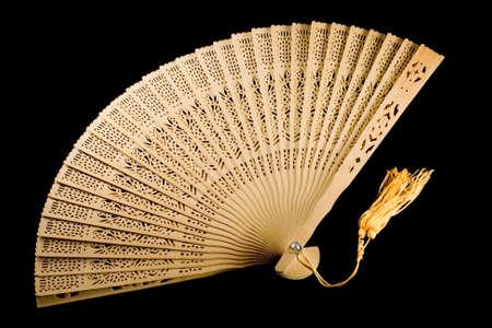unfold: Ancient fan unfolded on black background Stock Photo
