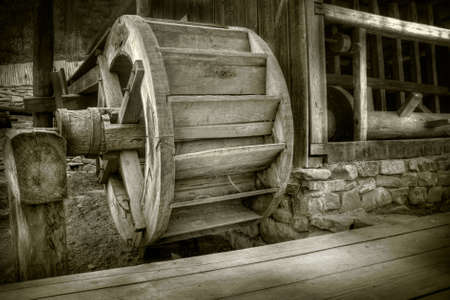 Antique waterwheel in a romanian village Stock Photo - 3138113