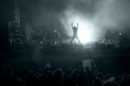 ecstatic: Concert: silhouette of rock singer in front of ecstatic crowd
