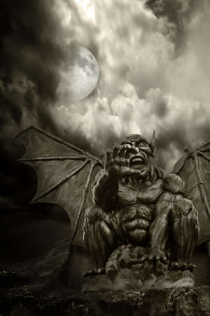 Night demon - close-up on frightening statue, with moon emerging from clouds Stock Photo