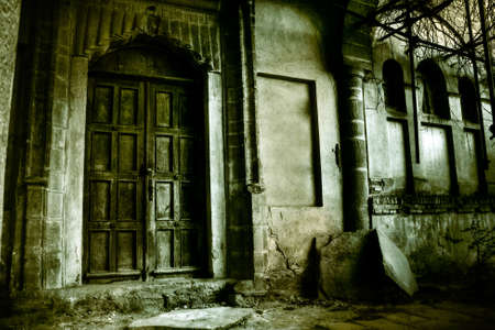 damaged house: Front of a creepy old house - vintage greenish version Stock Photo