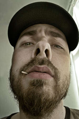 satire: Close-up portrait of an arrogant man - shallow DOF � focus on mouth and nose Stock Photo