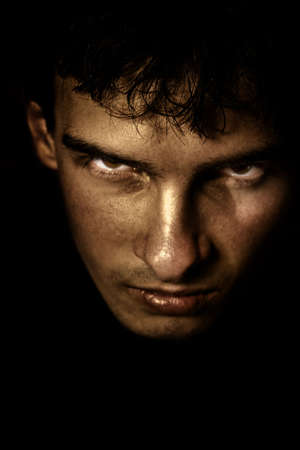 fearful: Low key portrait of evil looking man