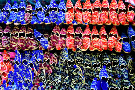 Rows of traditional turkish shoes in diverse colors Stock Photo - 3767824