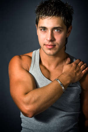 Portrait of sexy masculine model showing his muscular biceps Stock Photo