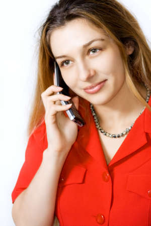 Smiling woman speaking at mobile phone on white background photo