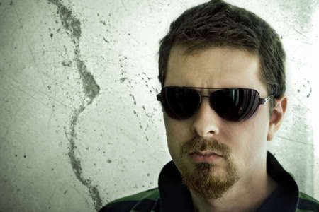 Dangerous looking guy, with beard and sunglasses Stock Photo - 3759580
