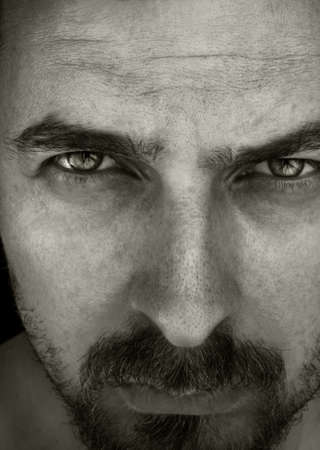 Close-up portrait of masculine and intense looking guy photo
