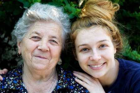 Portrait of young woman hugging her grandmother Stock Photo - 3785294