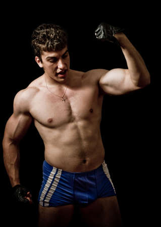 Muscular handsome man showing his force Stock Photo - 3819164