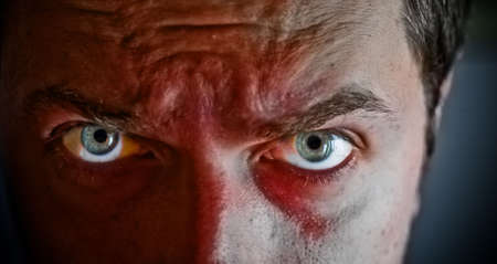 hypnotize: Close-up on criminal with blood on his face