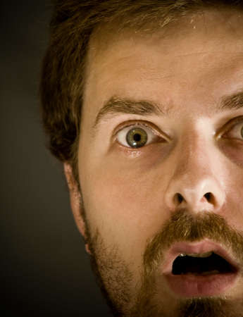 dreadful: Close-up portrait of very amazed guy