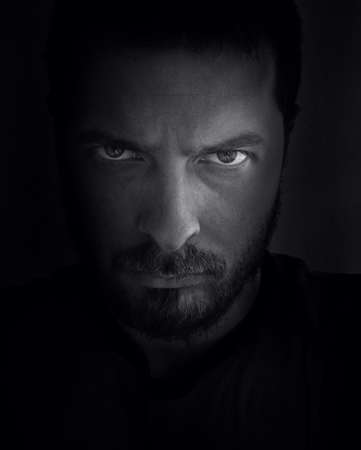 fierce: Low-key portrait of scary looking man