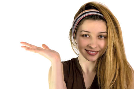 Beautiful smiling girl pointing or holding something on her palm  photo