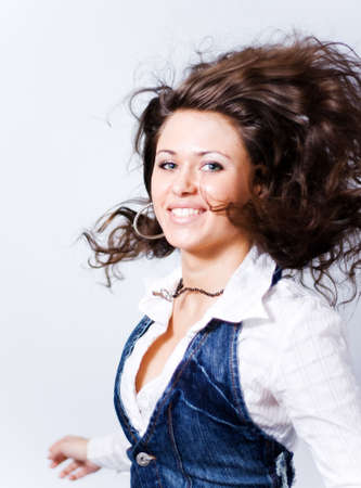 Portrait of happy young woman with flying moving hair Stock Photo - 3827322