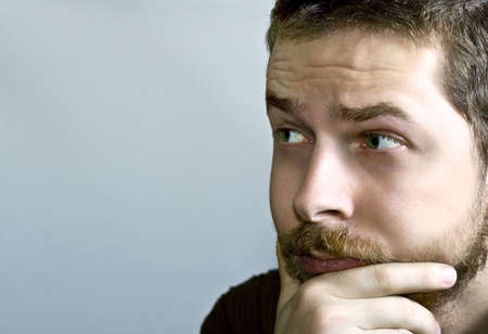 Portrait of young pensive bearded guy Stock Photo - 3827332