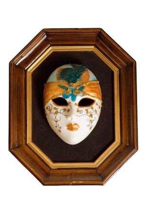 Venetian mask framed in wood isolated on white photo