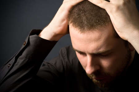 Frustrated businessman - business failure concept (or just a headache) photo