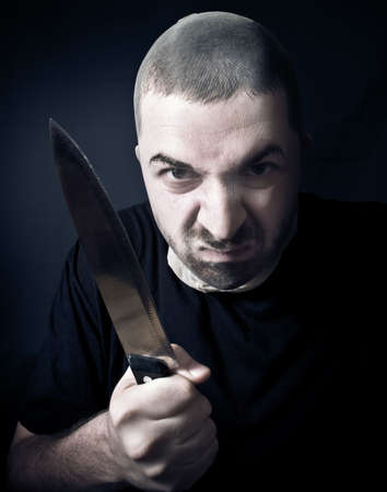 aggressor: Ugly criminal with stockings over face and knife in his hand Stock Photo