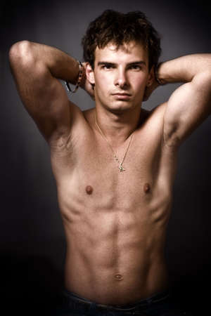 Athletic man showing his muscular torso photo