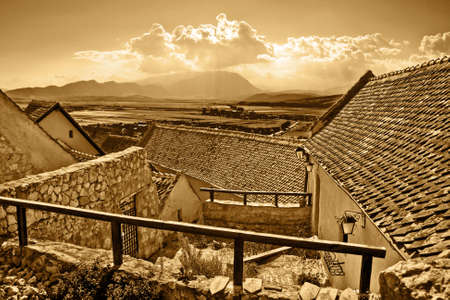 Panoramic sepia view of ancient rural town photo
