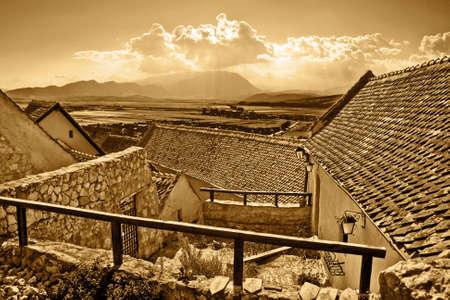 rural town: Panoramic sepia view of ancient rural town