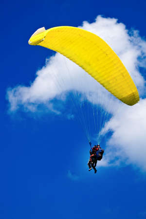 paraglide: Couple flying with the paraglide Stock Photo